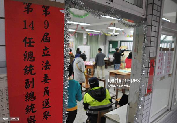 Taiwan election commission staff count votes at a polling station in Taipei on January 16 2016 Presidential polls closed in Taiwan on January 16...