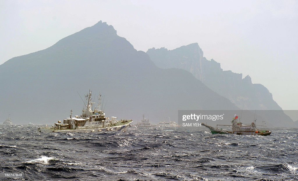 A Taiwan fishing boat is blocked by a Japan Coast Guard vessel near the disputed Diaoyu / Senkaku islands in the East China Sea on September 25 2012...