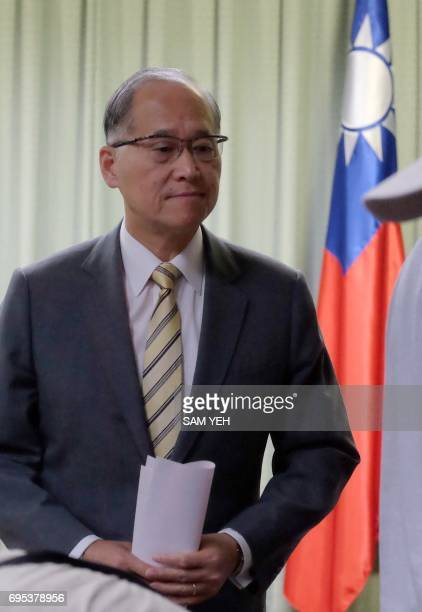 Taiwan Foreign Minister David Lee walks past Taiwan's national flag at the Foreign Ministry in Taipei on June 13 2017 Panama and China announced June...
