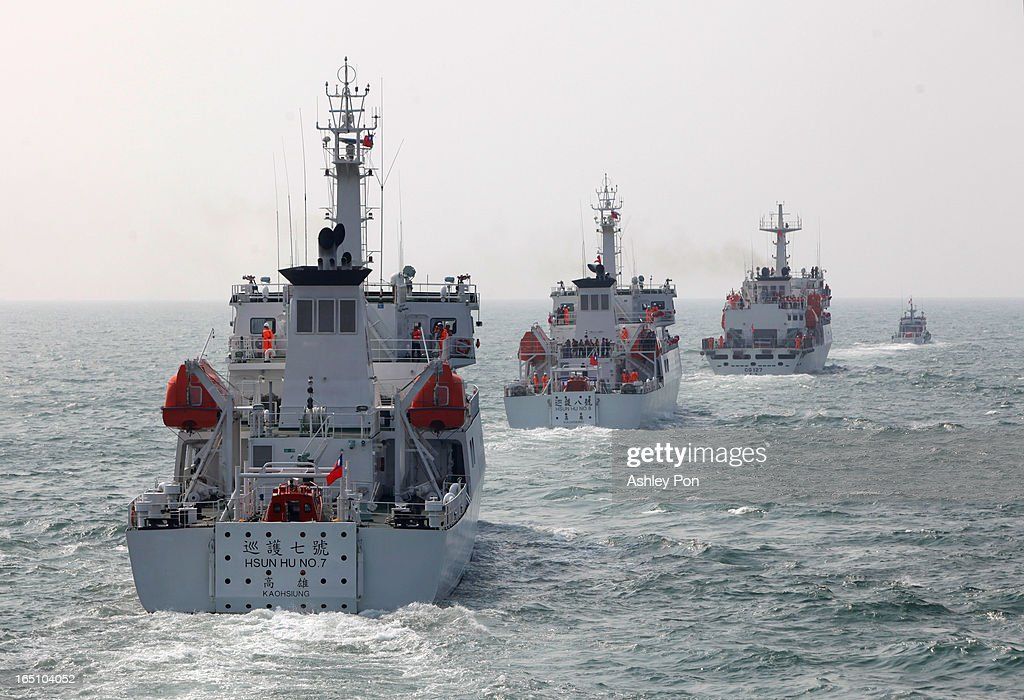 Taiwan Hsun Hu patrol ship no. 7 and new no 8 and new Xin Bei patrol ship are seen leaving the port after its commissioning ceremony on March 30, 2013 in Kaohsiung, Taiwan. President Ma Ying-jeou has unveiled two new ships that will patrol the waters off the disputed islands in the East China Sea at the centre of a current regional territorial row.