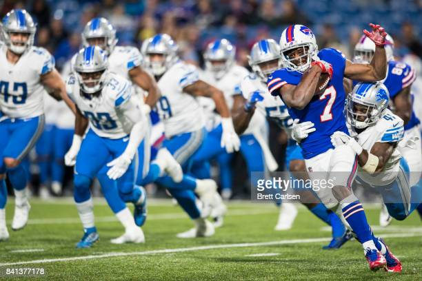 Taiwan Jones of the Buffalo Bills carries the ball as he is tackled by Rolan Milligan of the Detroit Lions during the second half on August 31 2017...