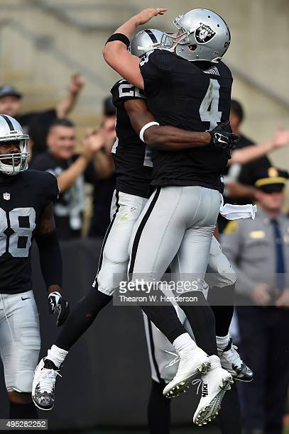 Taiwan Jones of the Oakland Raiders celebrates with Derek Carr after a 59yard touchdown against the New York Jets during their NFL game at Oco...