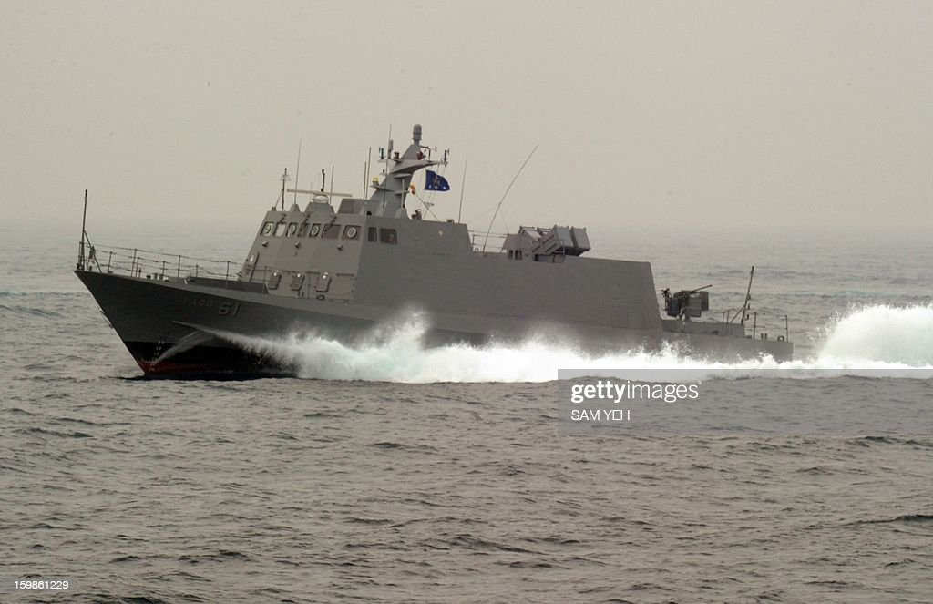 A Taiwan made Kuang-Hua Six missile boat patrol the sea near the Tsoying naval base in southern Kaohsiung city on January 22, 2013. Taiwan's frigates, missile boats, rescue helicopter and submarines are taking part in an annual training before the coming lunar new year. AFP PHOTO / Sam Yeh