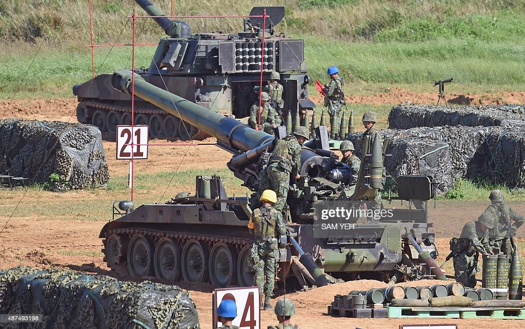 Taiwan military soldiers load an artillery shell into a 155millimeter howitzer during the Han Kuang 31 live fire drill in Hsinchu northern Taiwan on...