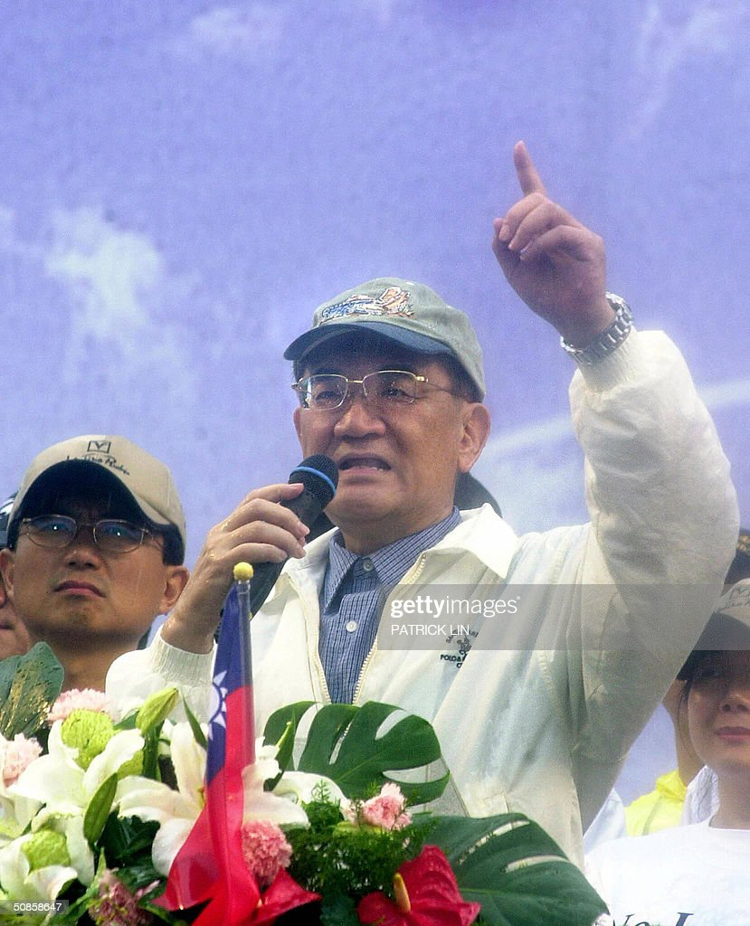 Taiwan opposition leader Lien Chan gestures during a protest rally in Taipei, 20 May 2004 as his political rival President Chen Shui-bian was sworn in for a second four-year term. The opposition is disputing Chen's re-election, claiming it was the result of an unfair election. Chen won the 20 March presidential polls by a razor-thin margin of 0.22 percent, or 30,000 votes.