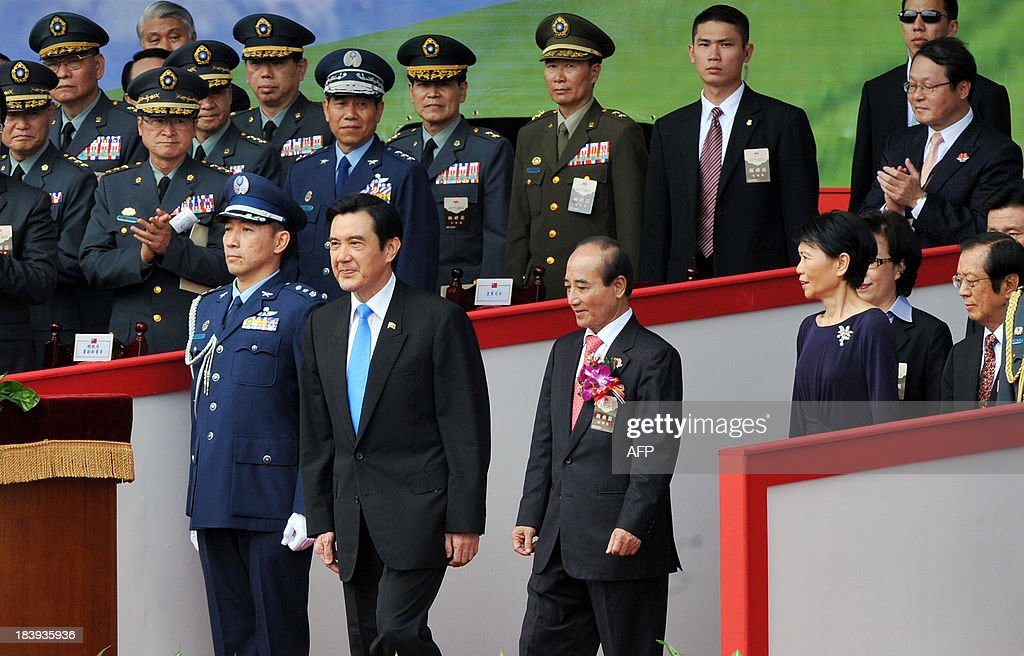 Taiwan President Ma Ying-jeou (front row, 2nd L) , first lady Chow Mei-ching (front row, 2nd R) and Parliament Speaker Wang Jin-pyng (front row, 3rd L) attend celebrations on National Day in Taipei on October 10, 2013. Taiwan President Ma Ying-jeou on October 10 hailed a new trade pact with China as protesters hurled shoes and carried a mock coffin to oppose the deal and demand his resignation. AFP PHOTO / Mandy CHENG