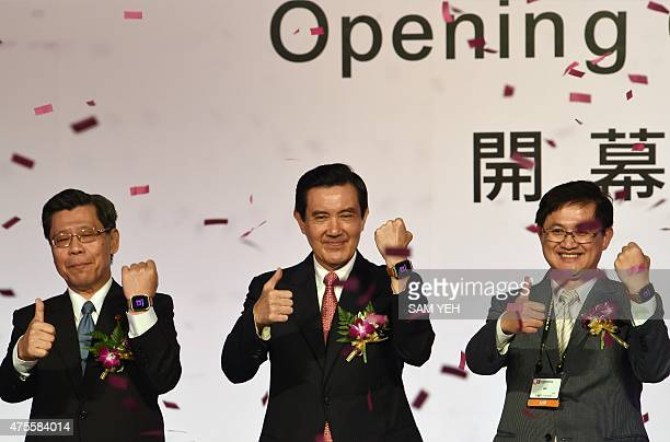 Taiwan President Ma Yingjeou gestures with local officials during the opening ceremony at the Computex trade show in Taipei on June 2 2015 President...
