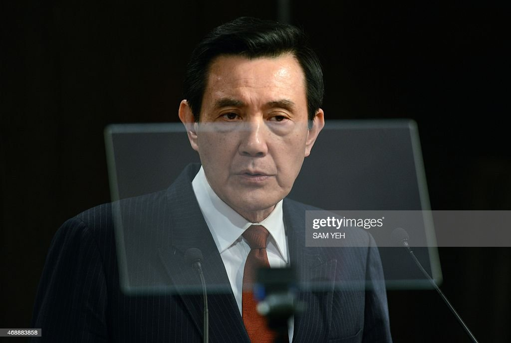 Taiwan President Ma Ying-jeou is seen through a teleprompter as he speaks to members of the Taiwan Foreign Correspondent Club (TFCC) in Taipei on April 8, 2015. Taiwan's embattled President Ma Ying-jeou said ties with China are 'back to normal' after major protests against a trade pact with Beijing last year, despite continued public unease over mainland influence. AFP PHOTO / Sam Yeh