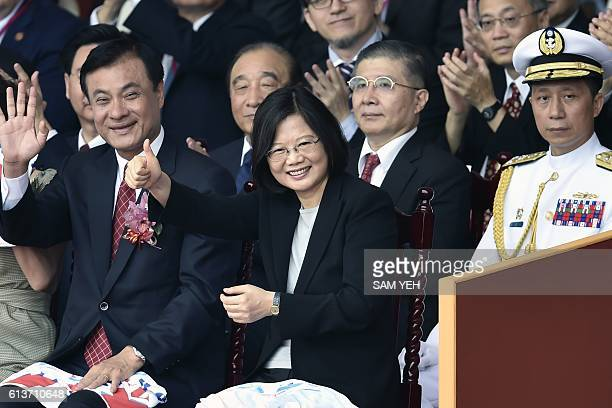 Taiwan President Tsai Ingwen gestures during National Day celebrations in front of the Presidential Palace in Taipei on October 10 2016 Taiwanese...