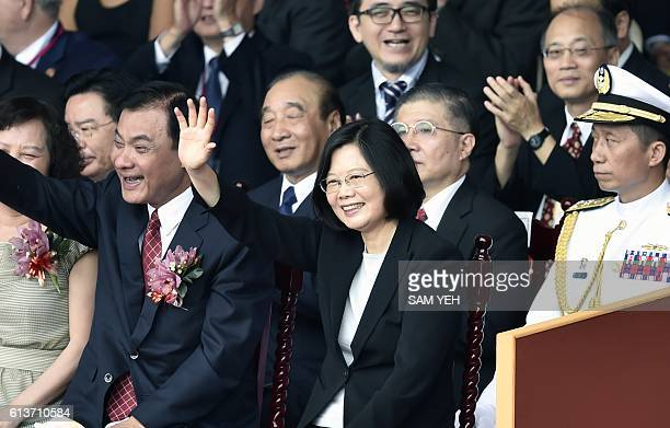 Taiwan President Tsai Ingwen waves during National Day celebrations in front of the Presidential Palace in Taipei on October 10 2016 Taiwanese...