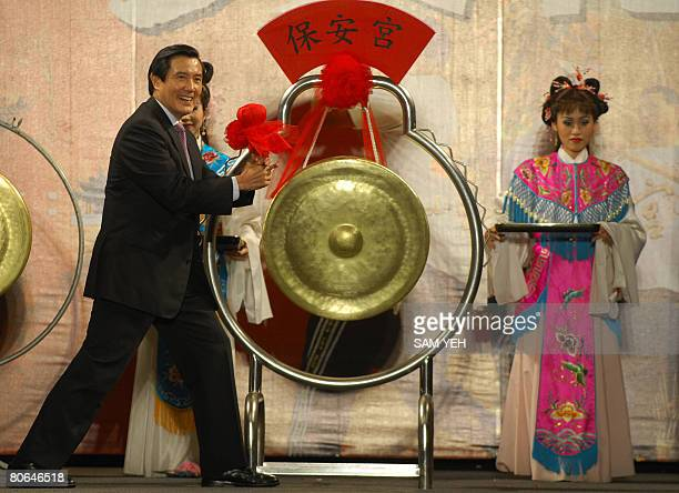Taiwan presidentelect Ma Yingjeou hits a gong to mark the opening of the Baocsheng Culture Festival at the Baoan temple in Taipei on April 12 2008...