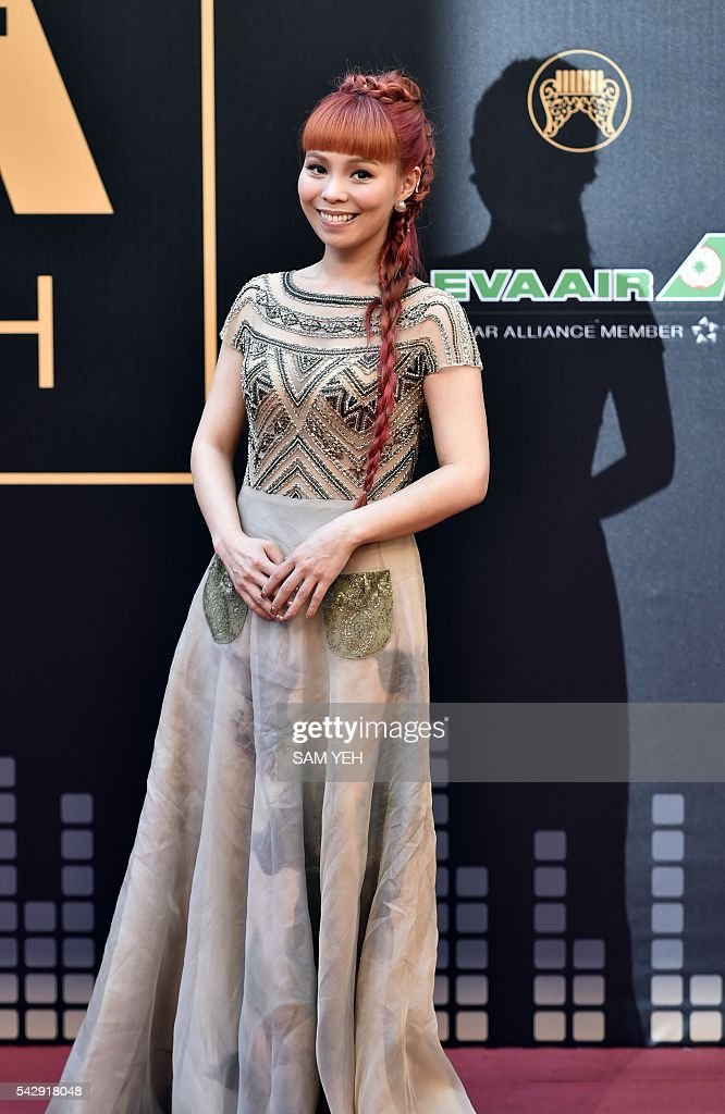 Taiwan singer Peggy Hsu arrives to attend the 27th Golden Melody Awards in Taipei on June 25, 2016. Some of Mandarin pop's biggest names have gathered for the annual Golden Melody music awards, with singers, songwriters and composers from Taiwan, China, Hong Kong, Singapore and Malaysia competing in more than 20 categories. / AFP / SAM YEH