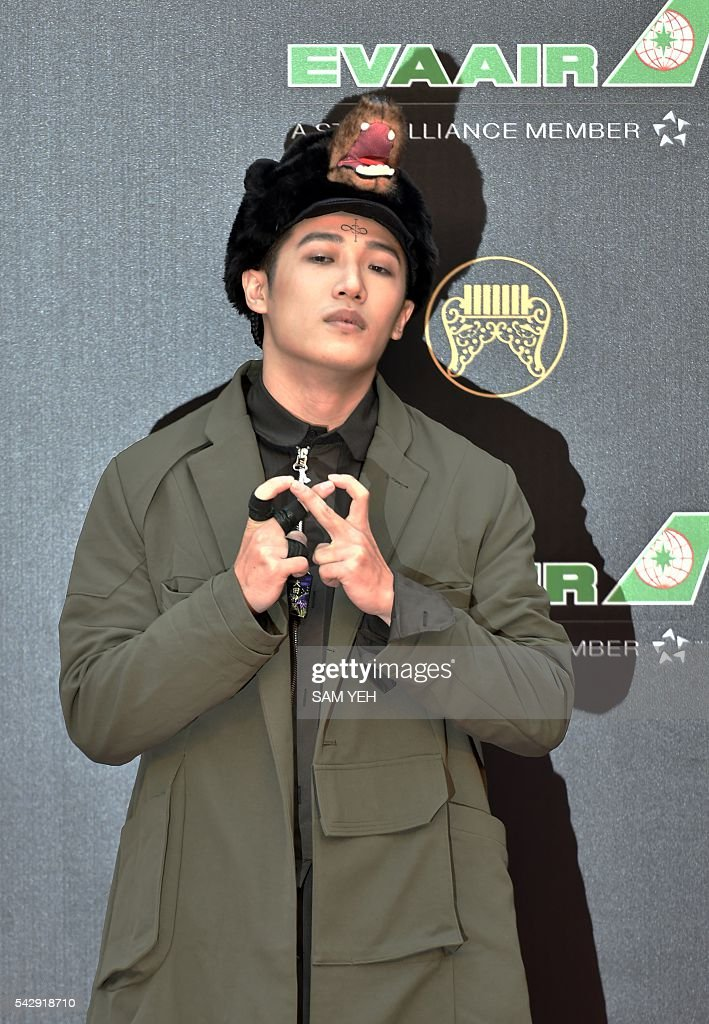 Taiwan singer PoeTek arrives to attend the 27th Golden Melody Awards in Taipei on June 25, 2016. Some of Mandarin pop's biggest names have gathered for the annual Golden Melody music awards, with singers, songwriters and composers from Taiwan, China, Hong Kong, Singapore and Malaysia competing in more than 20 categories. / AFP / SAM YEH