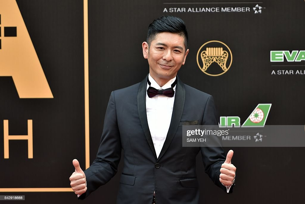 Taiwan singer Ric arrives to attend the 27th Golden Melody Awards in Taipei on June 25, 2016. Some of Mandarin pop's biggest names have gathered for the annual Golden Melody music awards, with singers, songwriters and composers from Taiwan, China, Hong Kong, Singapore and Malaysia competing in more than 20 categories. / AFP / SAM YEH