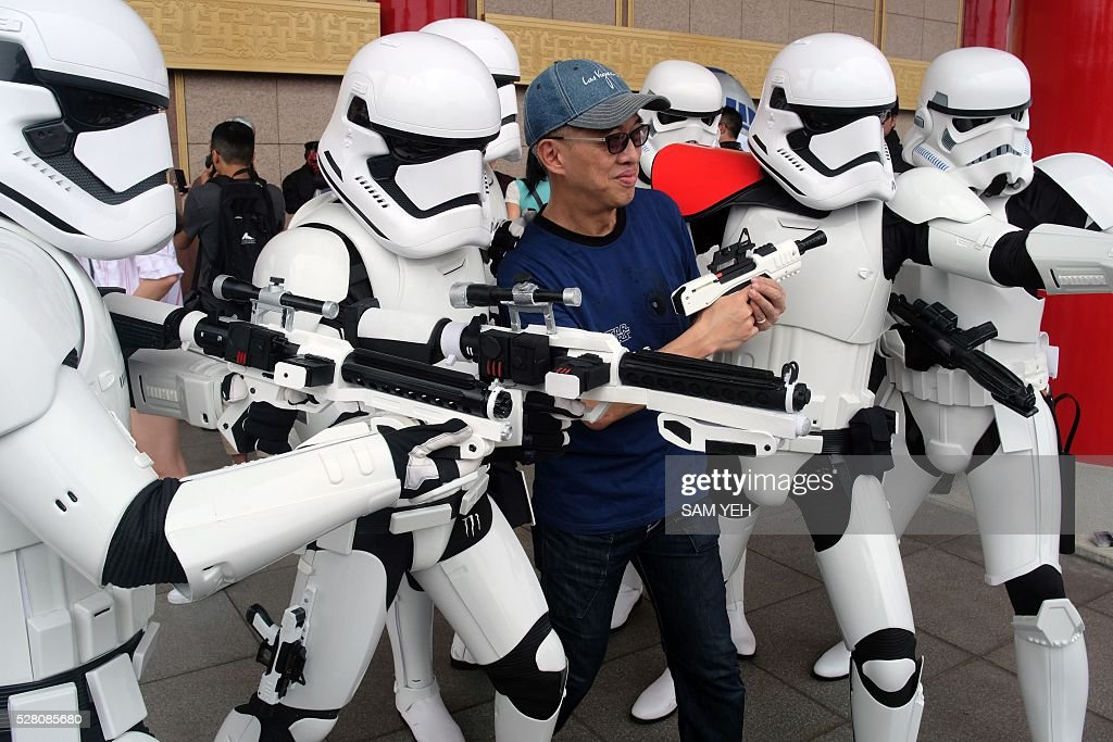 A Taiwan Star Wars fan poses for photo during the annual Star War Day in Taipei on May 4, 2016. Some 100 star wars fans dress the different costumes during a cosplay event to mark the annual Star War Day. / AFP / SAM YEH