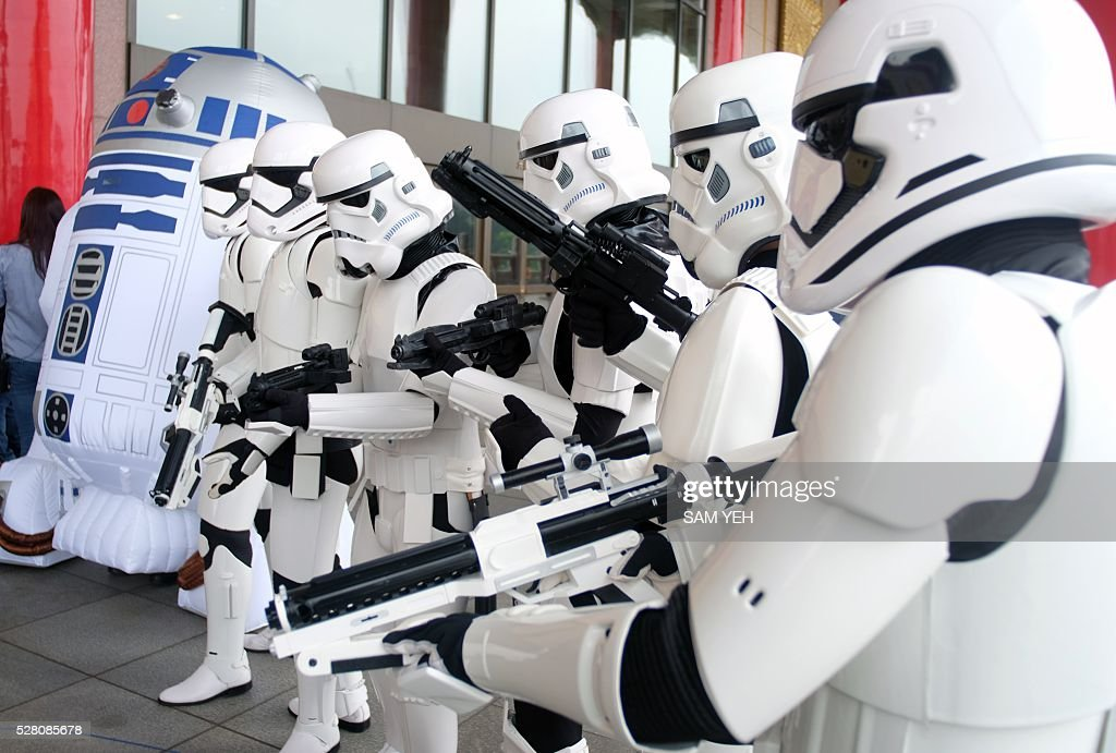 Taiwan Star Wars fans pose for photos during the annual Star War Day in Taipei on May 4, 2016. Some 100 star wars fans dress the different costumes during a cosplay event to mark the annual Star War Day. / AFP / SAM YEH