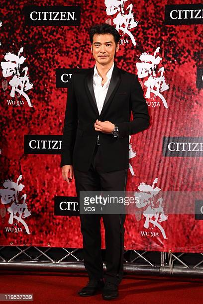 Taiwanese actor Takeshi Kaneshiro attends 'Wu Xia' movie premiere at Vie Show Cinemas on July 20 2011 in Taipei Taiwan of China