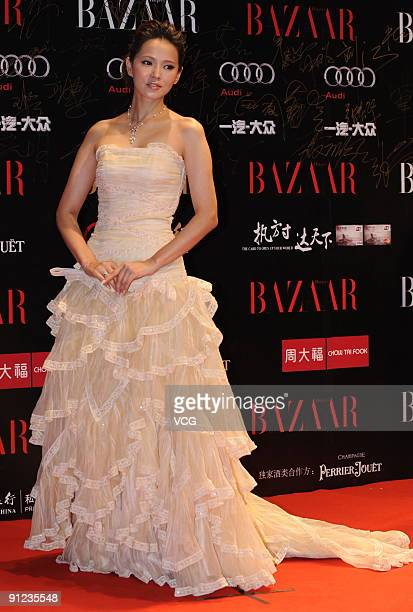 Taiwanese actress Annie Yi poses on the red carpet prior to the Bazaar charity event on September 28 2009 in Beijing China