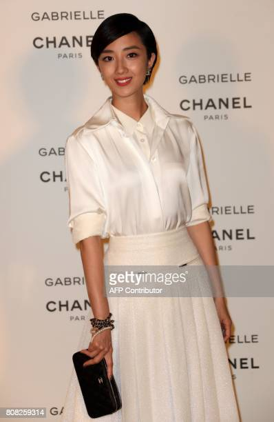Taiwanese actress Gwei LunMei poses during a photocall upon arriving at a launch event for the new Chanel perfume 'Gabrielle' at the Palais de Tokyo...