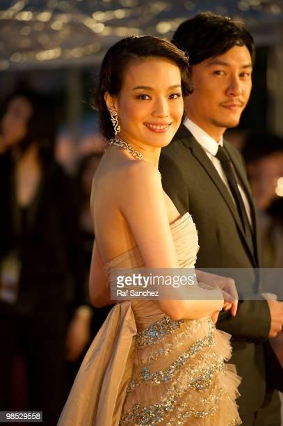Taiwanese actress Shu Qi arrives with actor Chang Chen at the 29th Hong Kong Film Awards at the The Hong Kong Cultural Centre on April 18 2010 in...