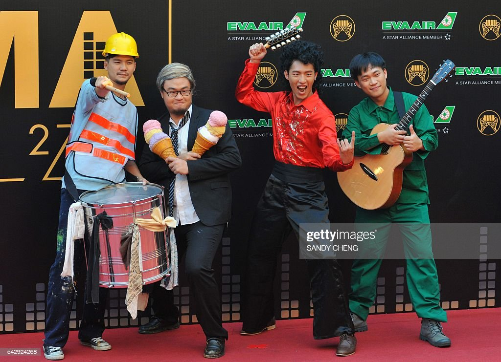 Taiwanese band Chang and Lee arrives to attend the 27th Golden Melody Awards in Taipei on June 25, 2016. Some of Mandarin pop's biggest names have gathered for the annual Golden Melody music awards, with singers, songwriters and composers from Taiwan, China, Hong Kong, Singapore and Malaysia competing in more than 20 categories. / AFP / SANDY