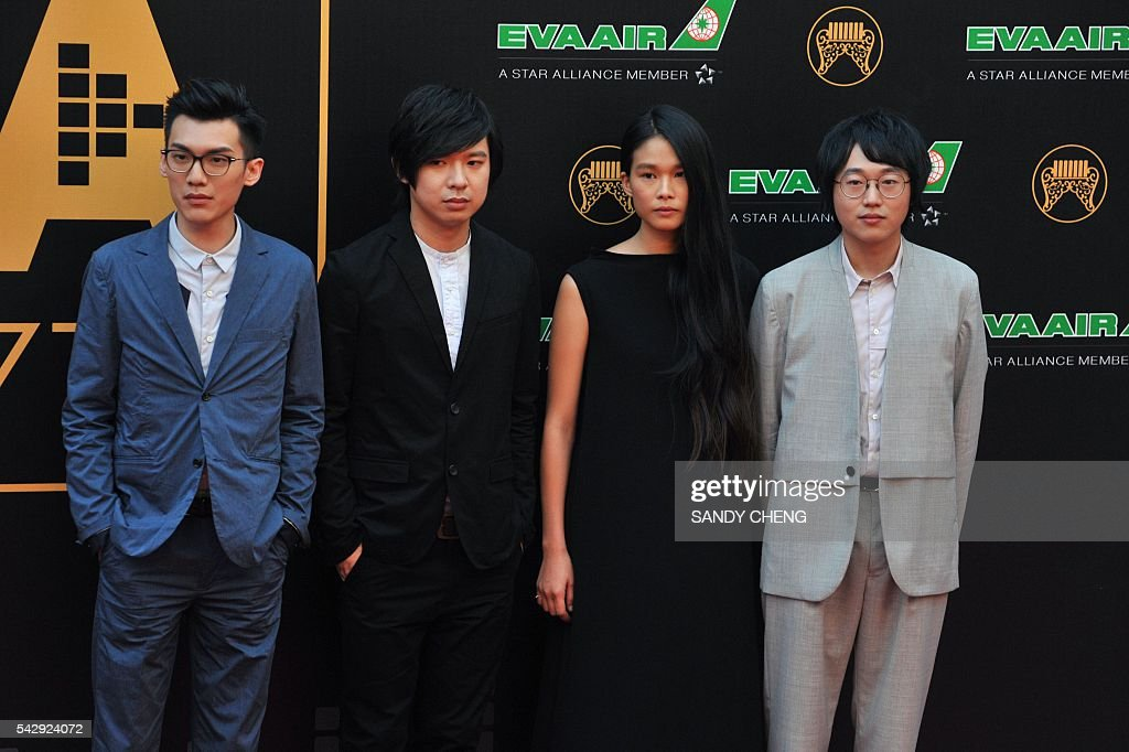 Taiwanese band Hello Nico arrives to attend the 27th Golden Melody Awards in Taipei on June 25, 2016. Some of Mandarin pop's biggest names have gathered for the annual Golden Melody music awards, with singers, songwriters and composers from Taiwan, China, Hong Kong, Singapore and Malaysia competing in more than 20 categories. / AFP / SANDY
