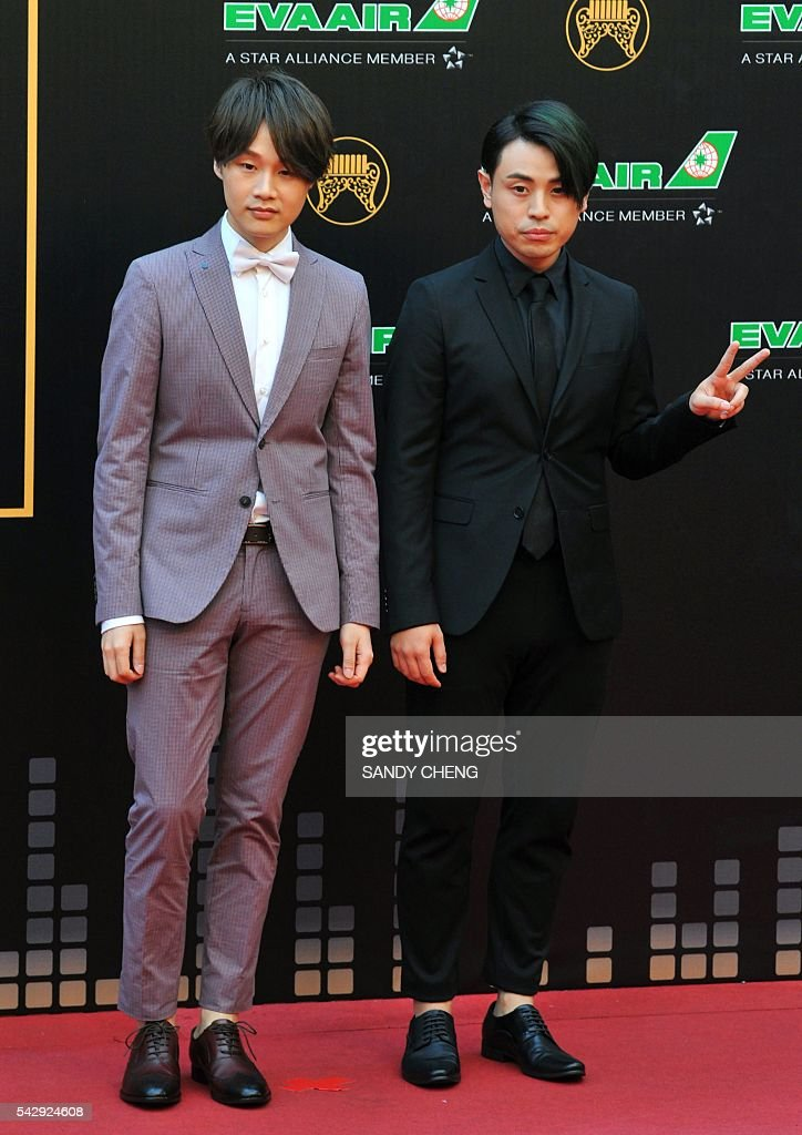 Taiwanese band io arrives to attend the 27th Golden Melody Awards in Taipei on June 25, 2016. Some of Mandarin pop's biggest names have gathered for the annual Golden Melody music awards, with singers, songwriters and composers from Taiwan, China, Hong Kong, Singapore and Malaysia competing in more than 20 categories. / AFP / SANDY