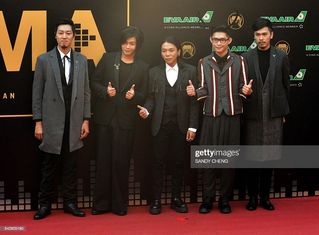 Taiwanese band Mixer Mi Sir arrives to attend the 27th Golden Melody Awards in Taipei on June 25, 2016. Some of Mandarin pop's biggest names have gathered for the annual Golden Melody music awards, with singers, songwriters and composers from Taiwan, China, Hong Kong, Singapore and Malaysia competing in more than 20 categories. / AFP / SANDY