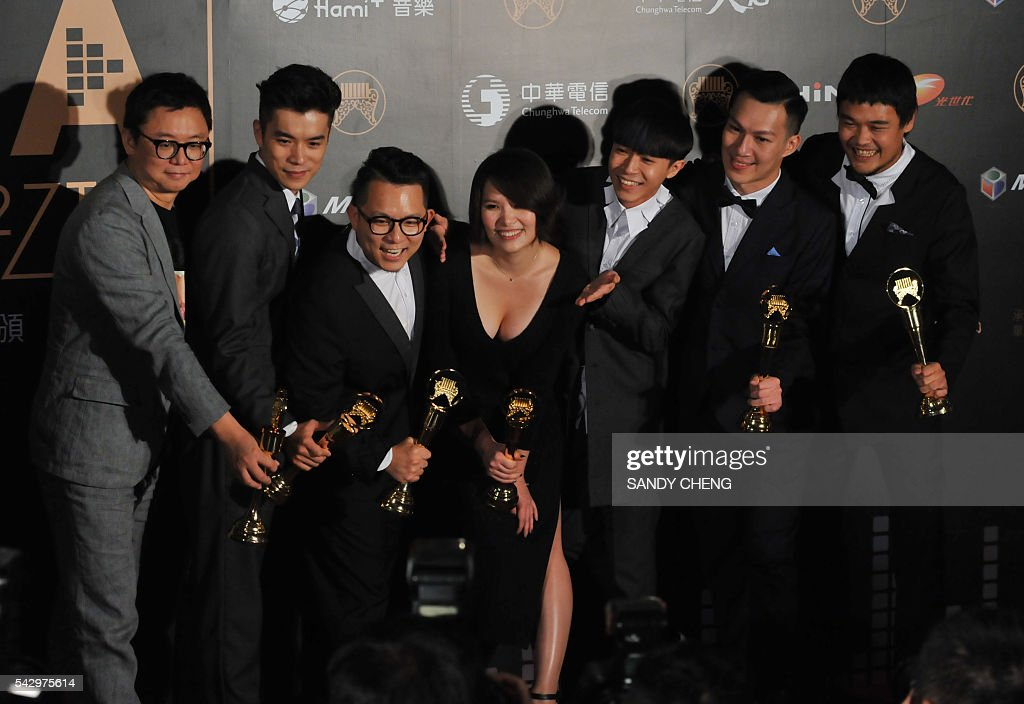 Taiwanese band Sodagreen display their trophies after winning the Best Band, Best Lyricist and Best Music Arranger awards at the 27th Golden Melody Awards in Taipei on June 25, 2016. Some of Mandarin pop's biggest names have gathered for the annual Golden Melody music awards, with singers, songwriters and composers from Taiwan, China, Hong Kong, Singapore and Malaysia competing in more than 20 categories. / AFP / SANDY