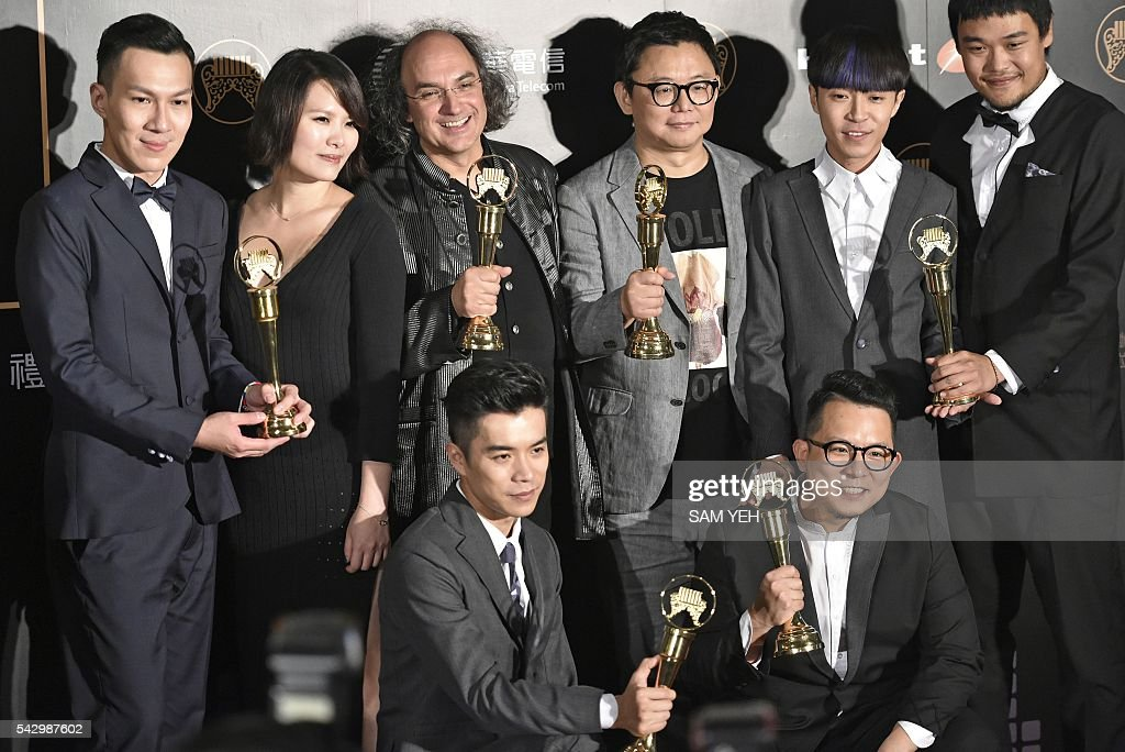 Taiwanese band Sodagreen display trophies after winning the Best Album Producer of the Year, Best Band, Best Music Arranger, Best Lyricist and Best Mandarin Album awards during the 27th Golden Melody Awards in Taipei on June 25, 2016. Some of Mandarin pop's biggest names have gathered for the annual Golden Melody music awards, with singers, songwriters and composers from Taiwan, China, Hong Kong, Singapore and Malaysia competing in more than 20 categories. / AFP / SAM YEH