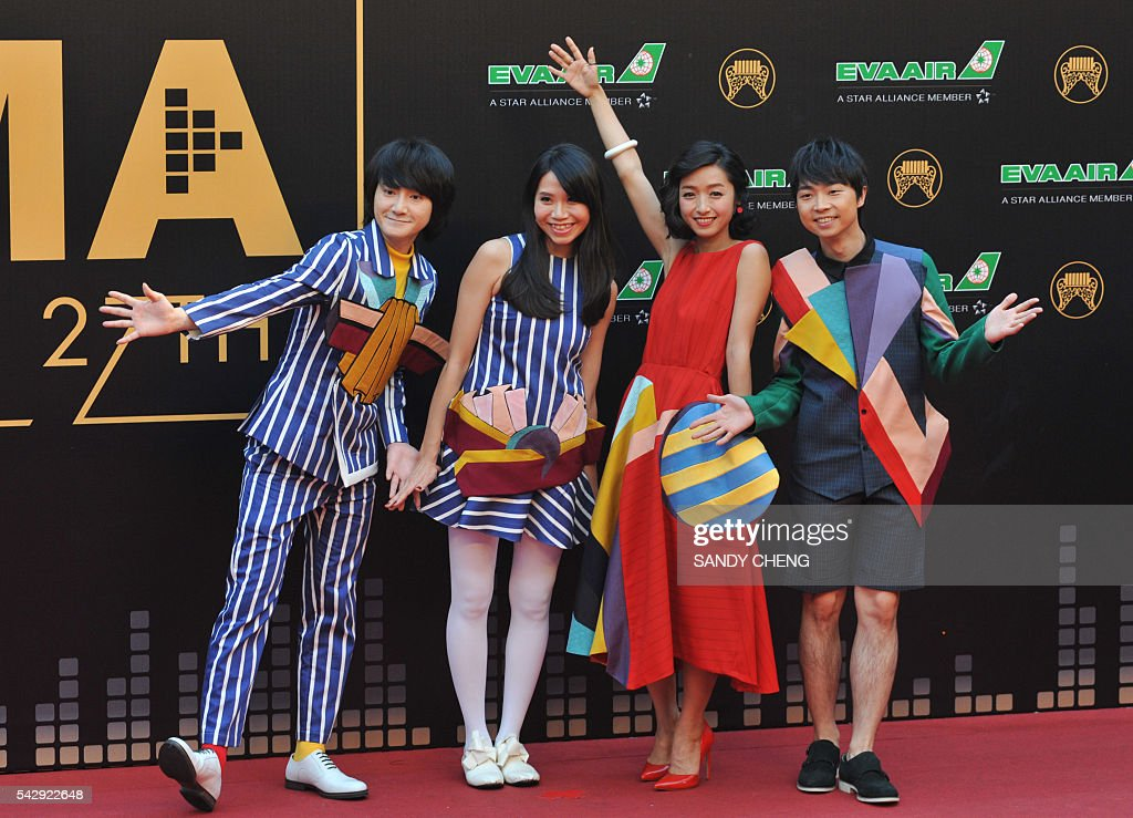 Taiwanese band Wonfu arrives to attend the 27th Golden Melody Awards in Taipei on June 25, 2016. Some of Mandarin pop's biggest names have gathered for the annual Golden Melody music awards, with singers, songwriters and composers from Taiwan, China, Hong Kong, Singapore and Malaysia competing in more than 20 categories. / AFP / SANDY