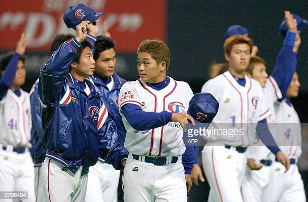 Taiwanese baseball players celebrate their victory over China at the Asian Championship at the Sapporo Dome in Hokkaido northern Japan 07 November...