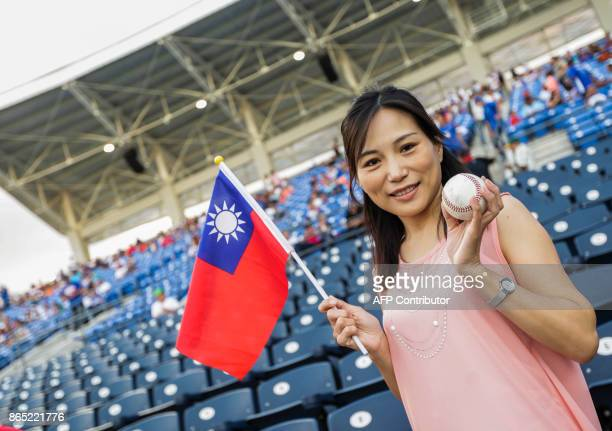 A taiwanese citizen waves a Taiwan´s flag before the friendly game of the National Baseball Team of Nicaragua against the National Baseball Team of...