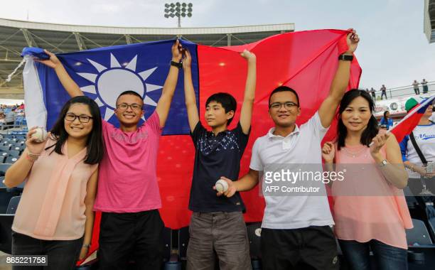 Taiwanese citizens wave a Taiwan´s flag before the friedly game of the National Baseball Team of Nicaragua against the National Baseball Team of...