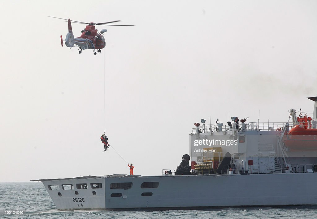Taiwanese Coast Guards take part in a helipoter hoist operation exercise on March 30, 2013 in Kaohsiung, Taiwan. President Ma Ying-jeou has unveiled two new ships that will patrol the waters off the disputed islands in the East China Sea at the centre of a current regional territorial row.