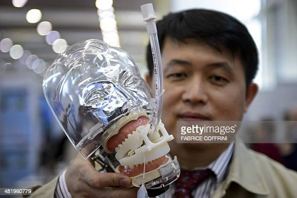 Taiwanese inventor Tseng ChungChih presents his creation a medical oral protector for emergency endotracheal intubation that avoids wounding the...
