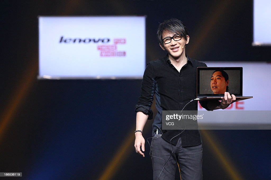 Taiwanese magician Lu 'Louis' Chen performs during the launching ceremony of Yoga Tablet at China National Convention Center on November 1, 2013 in Beijing, China. The world's largest personal computer maker Lenovo launched its high-end product Yoga today.