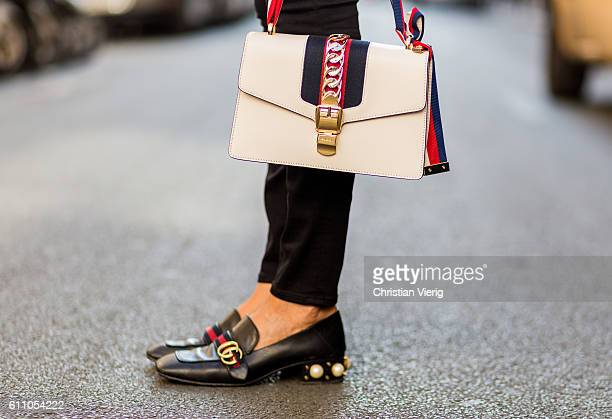 Taiwanese model Chalitda Bidinger wearing Gucci bag and shoes on September 28 2016 in Paris France