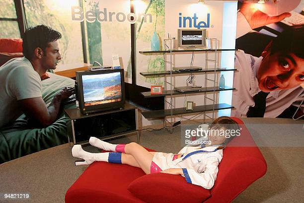 Taiwanese model for Intel Corp sits in a display created by to illustrate the future of convergence between consumer electronics and computing...