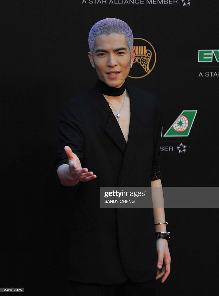 Taiwanese pop singer Jam Hsiao arrives to attend the 27th Golden Melody Awards in Taipei on June 25, 2016. Some of Mandarin pop's biggest names have gathered for the annual Golden Melody music awards, with singers, songwriters and composers from Taiwan, China, Hong Kong, Singapore and Malaysia competing in more than 20 categories. / AFP / SANDY