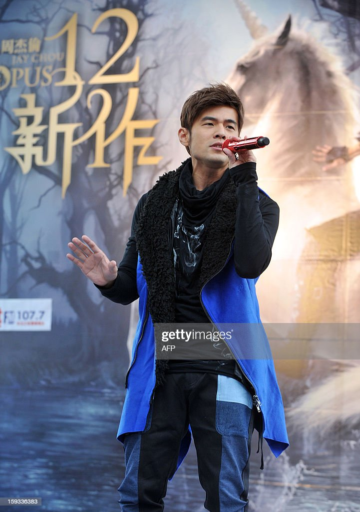 Taiwanese pop singer Jay Chou performs during a promotional signing event for his new album, 'Opus 12', in Taipei on January 12, 2013. Chou's new album was released on December 28, 2012. AFP PHOTO / Mandy CHENG