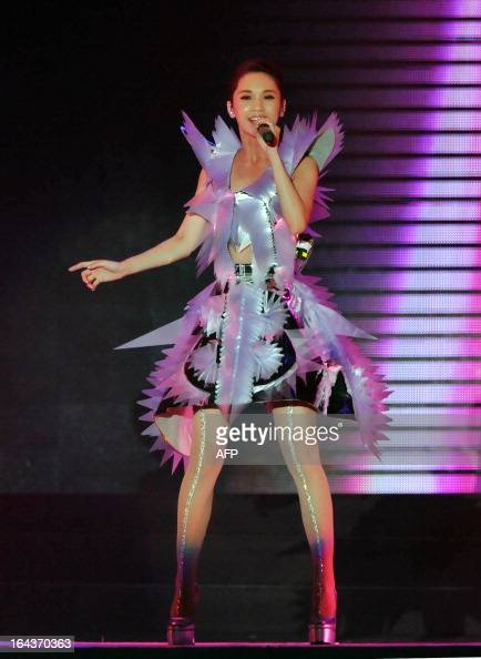 Taiwanese pop singer Rainie Yang performs during her Love Voyage concert at the Taipei Arena in Taipei on March 23 2013 AFP PHOTO / Mandy CHENG