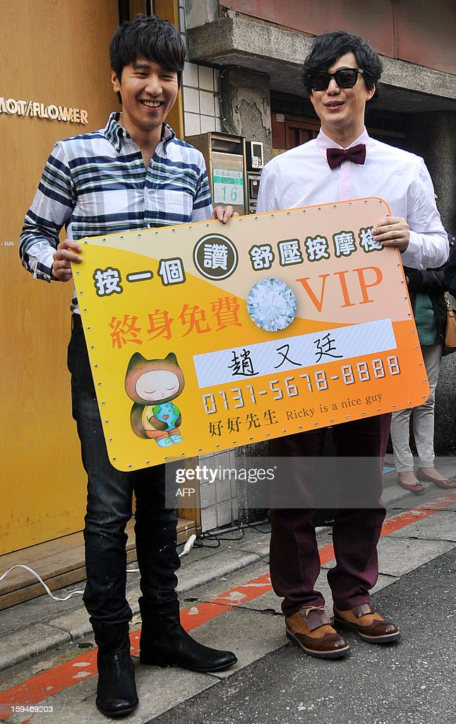 Taiwanese pop singer Ricky Xiao (R) and Taiwanese actor Mark Chao (L) pose for photos during a music video shoot for television of the album title track 'Ricky is a nice guy' in Taipei on January 14, 2013. Xiao's new album will be released on January 30, 2013. AFP PHOTO / Mandy CHENG