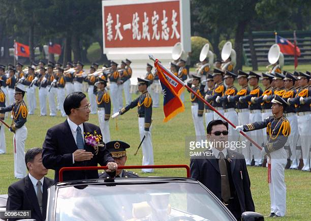 Taiwanese President Chen Shuibian salutes while inspecting the students of Chinese Military Academy in Kaohsiung southern Taiwan 16 June 2004 Some...