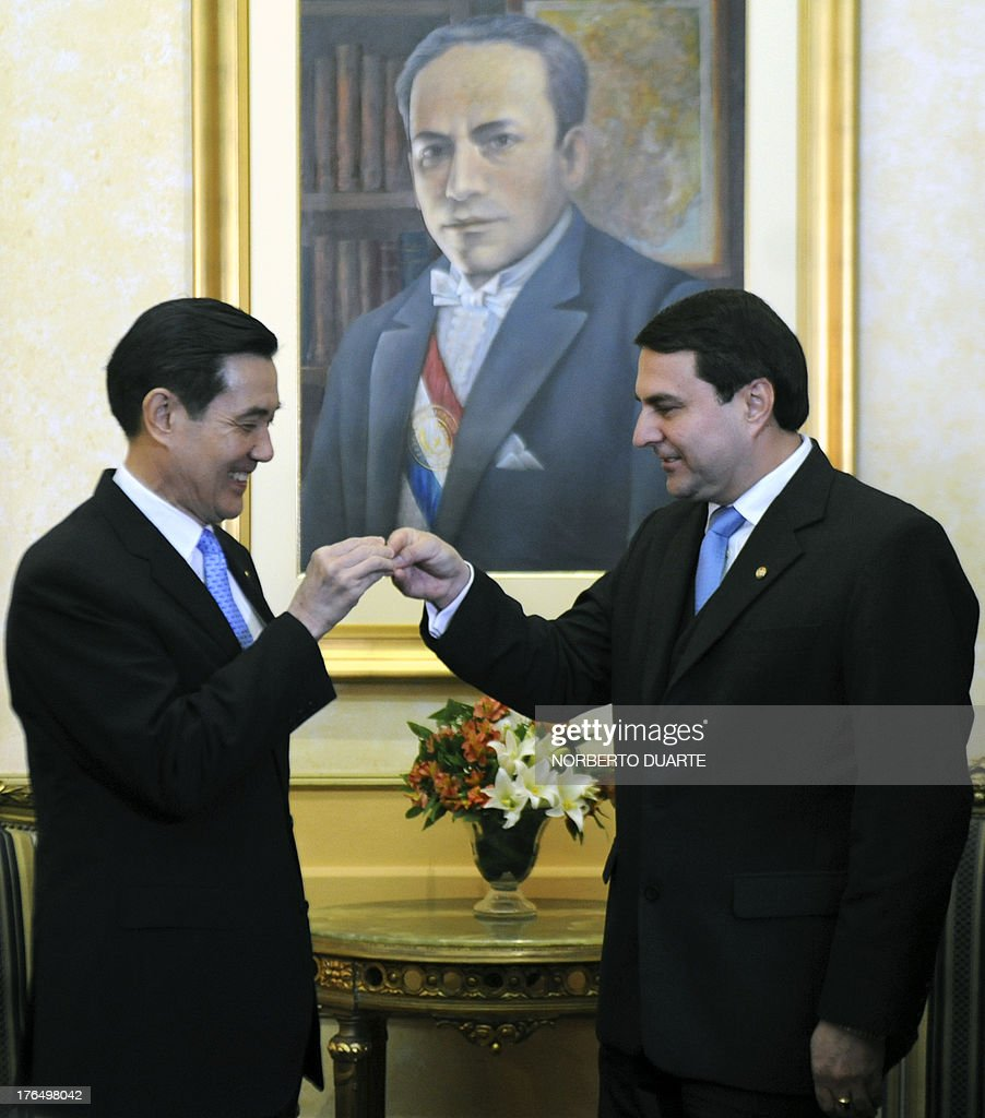 Taiwanese President Ma Ying Jeuo and Paraguayan outgoing President Federico Franco greet each other at the presidential palace in Asuncion on August...