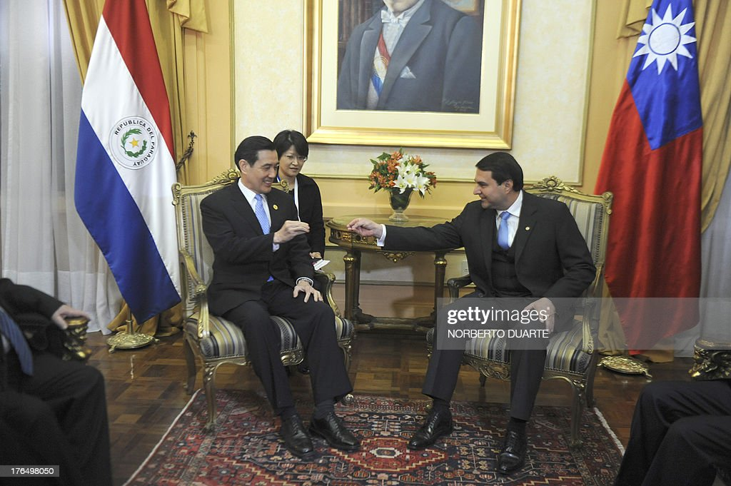 Taiwanese President Ma Ying Jeuo and Paraguayan outgoing President Federico Franco meet at the presidential palace in Asuncion on August 14 2013 Ma...
