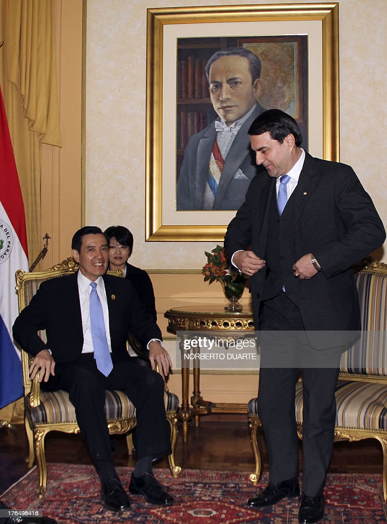 Taiwanese President Ma Yingjeou meets with Paraguayan outgoing President Federico Franco at the presidential palace in Asuncion on August 14 2013 Ma...