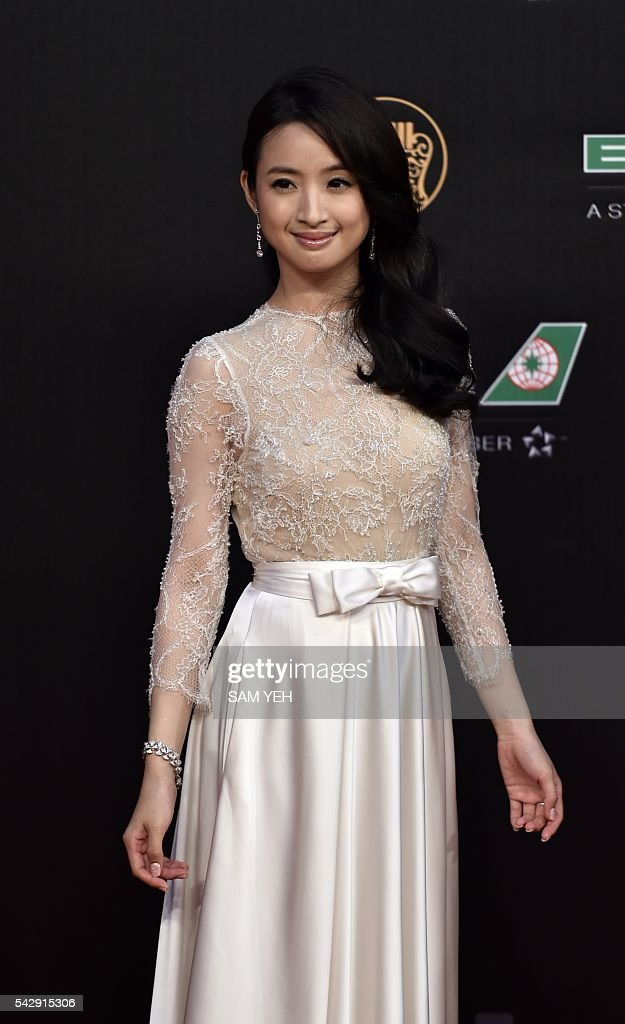 Taiwanese singer and actress Ariel Lin arrives to attend the 27th Golden Melody Awards in Taipei on June 25, 2016. Some of Mandarin pop's biggest names have gathered for the annual Golden Melody music awards, with singers, songwriters and composers from Taiwan, China, Hong Kong, Singapore and Malaysia competing in more than 20 categories. / AFP / SAM YEH