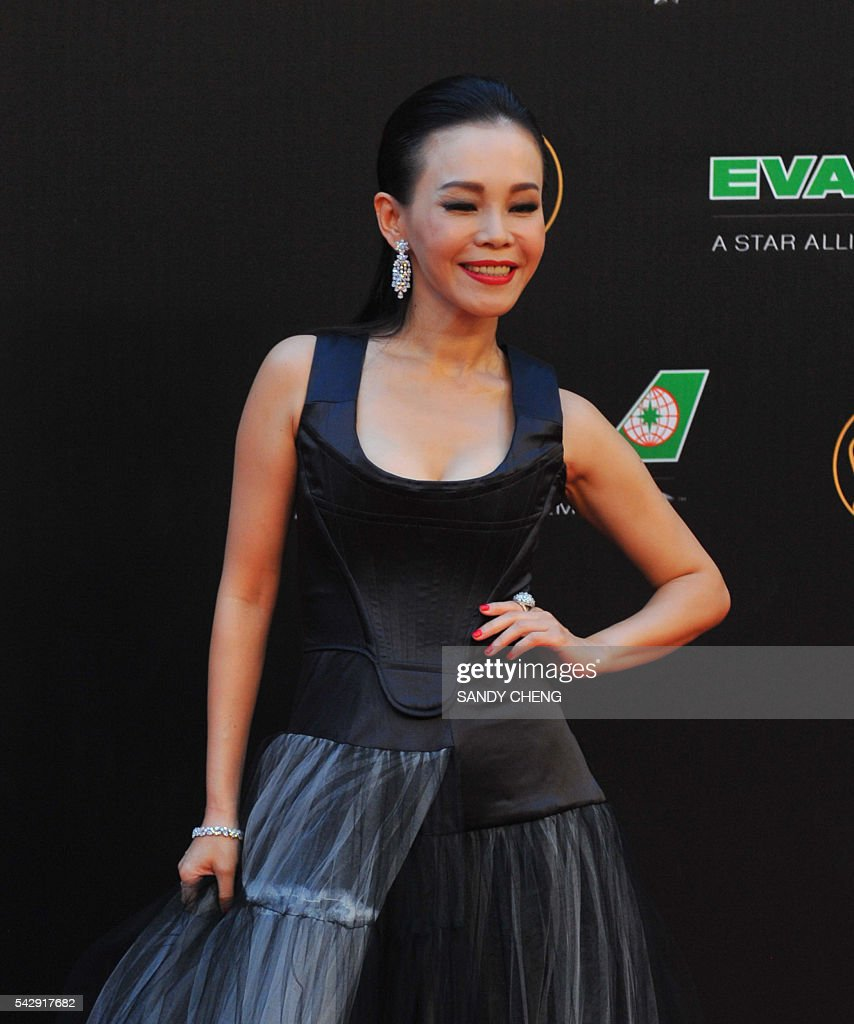 Taiwanese singer Julia Peng arrives to attend the 27th Golden Melody Awards in Taipei on June 25, 2016. Some of Mandarin pop's biggest names have gathered for the annual Golden Melody music awards, with singers, songwriters and composers from Taiwan, China, Hong Kong, Singapore and Malaysia competing in more than 20 categories. / AFP / SANDY
