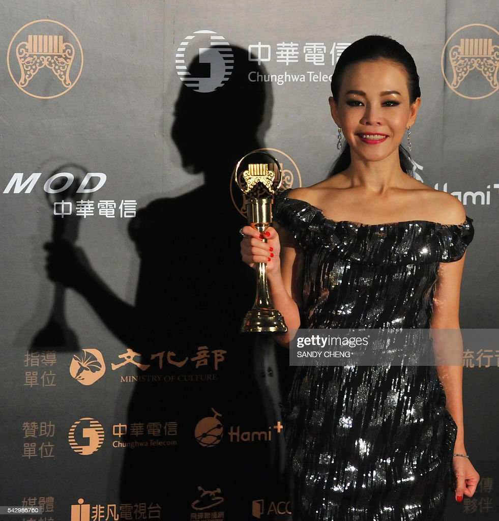Taiwanese singer Julia Peng displays her trophy after winning the Best Female Singer Award at the 27th Golden Melody Awards in Taipei on June 25, 2016. Some of Mandarin pop's biggest names have gathered for the annual Golden Melody music awards, with singers, songwriters and composers from Taiwan, China, Hong Kong, Singapore and Malaysia competing in more than 20 categories. / AFP / SANDY